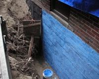 plumber in Toronto waterproofing a basement