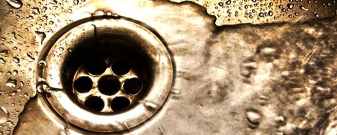 water going down sink drain