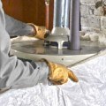 plumber-installing-water-heater-jacket