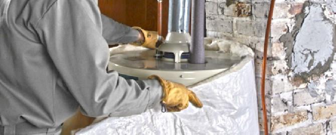 plumber-installing-water-heater-jacket