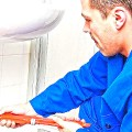 plumber providing services in a Toronto home