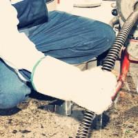 plumber performing drain snaking service
