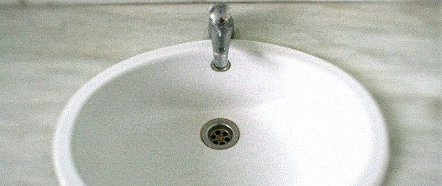bathroom sink in need of drain inspection and cleaning