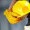 licensed contractor holding hardhat
