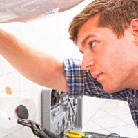 apprentice repairing sink