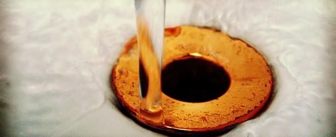 water running down drainpipe