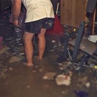 men assessing damage after a serious basement flooding