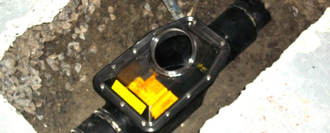 backwater valve installed in the basement of a toronto home before the ground has been back-filled and fixed