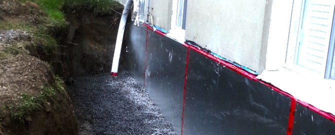 home in toronto receiving foundation waterproofing services showcasing a dug out foundation and waterproofing membrane