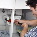 toronto home owner attempting diy drain cleaning procedure before ruining his kitchen