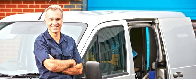 plumbers toronto residents trust standing next to a white van with plumbing tools visible