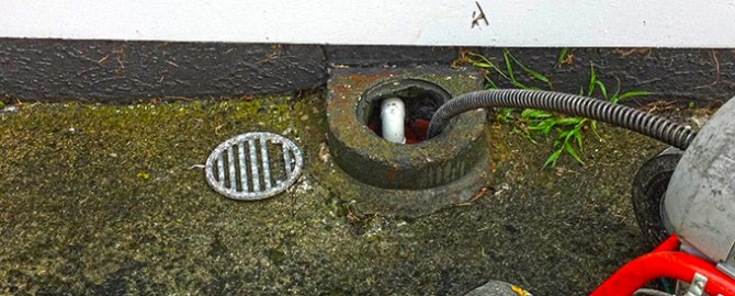 blocked drain infront of a toronto home being drain snaked