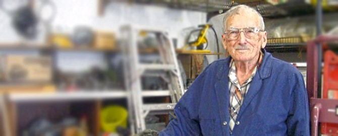 lorne figley, canada's oldest plumber, standing infront of some plumbing supplies