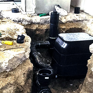 waterproofing and flood prevention devices in the basement of a toronto home