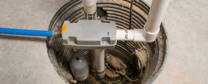 Sump pump inspection taking place in the basement of a Toronto home.