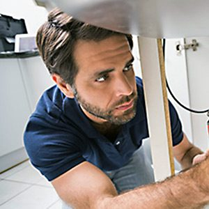 georgetown plumber hard at work installing plumbing in a home