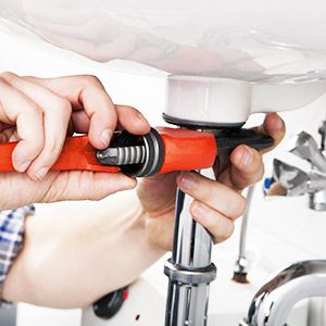 richmond hill plumber repairing a clogged sink drain in a home
