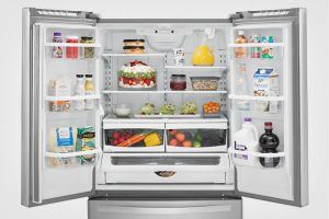 refrigerator open with produce after being service by a plumber